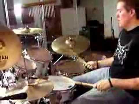 Joshua Miller playing drums