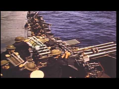 Gun crews aboard carriers of US Task Force fire guns at Japanese aircraft during ...HD Stock Footage