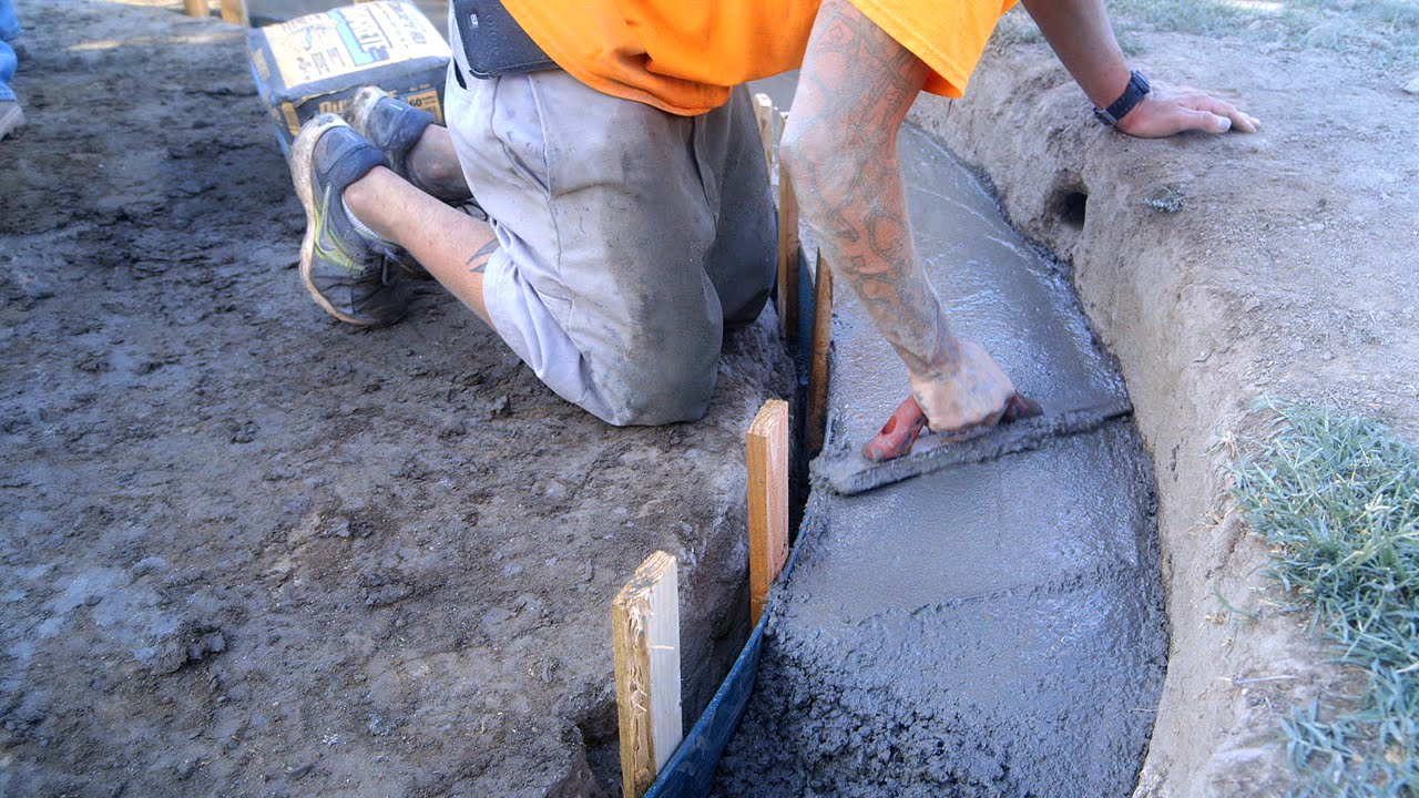 Diy koi pond construction finishing pouring concrete for Concrete pond construction