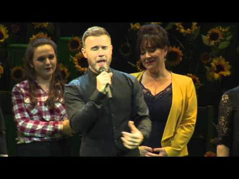 Gary Barlow on stage with 'The Girls'