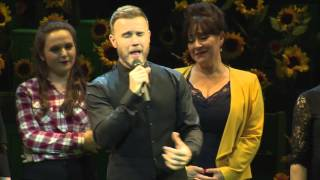 Gary Barlow on stage with