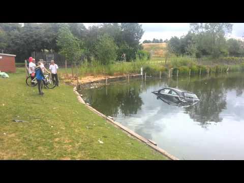 Car in Bilston fishing pool