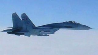 Russian fighter jet spotted twenty feet from US Navy plane