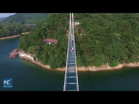 Walking on water: China's first glass bridge across islets opens in Hunan