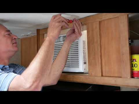Solar air conditioner install in RV microwave cabinet