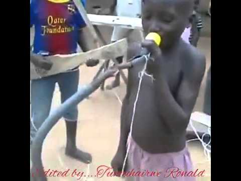 Ugandans kids playing music instruments in woods and, plastic