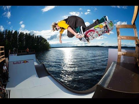 Skateboarding on a floating miniramp in central Finland