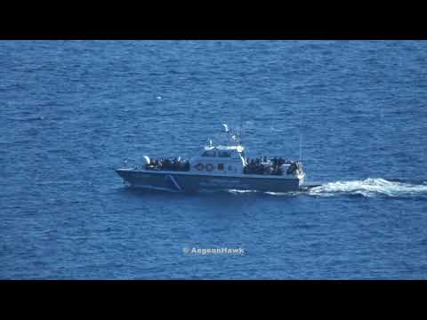Hellenic Coast Guard patrol boat transporting immigrants to Chios port.