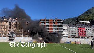 video: Fire breaks out at Andorra's national stadium before England football match