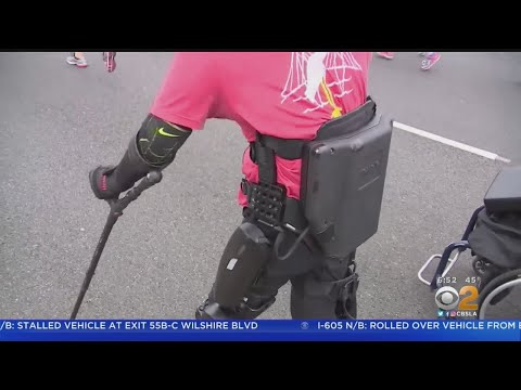 Crash & AJ - Man Who's Paralyzed Walks a Full Marathon in Robotic Suit