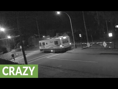 RV takes out stop sign and drives away
