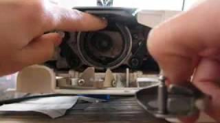 Reponer mecanismo de la bobina