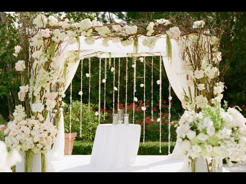 Wooden wedding arch with floral garland youtube wooden wedding arch with floral garland junglespirit