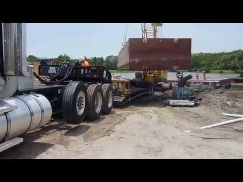 Seawall construction site barge demobilization with crane. V2