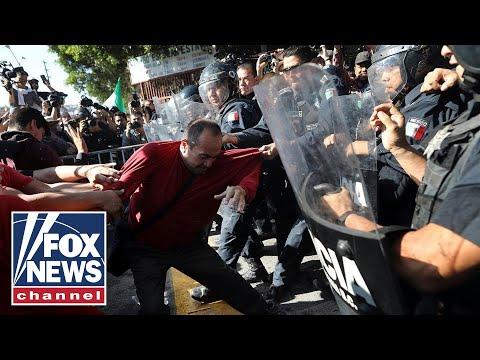 Anticaravan protesters clash with police in Tijuana