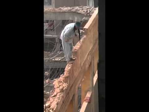 Demolition From Top Of Wall