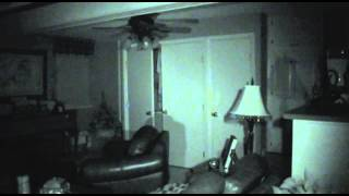 Ghost caught on tape opening door!