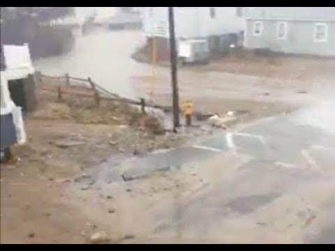 Waves plowing through neighborhoods in Scituate