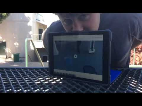 Drew balancing IPad on nose at Mill Valley Middle School