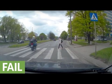Driver blowing through pedestrian crosswalk receives instant karma