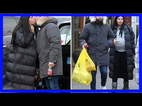 Heavily pregnant cara de la hoyde kisses boyfriend nathan massey as they go christmas shopping afte