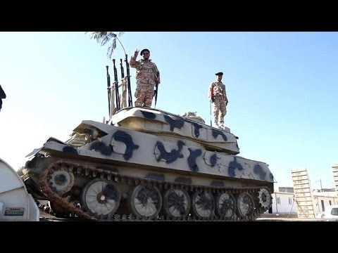 A Libyan militia hands over its Tripoli base to the authorities