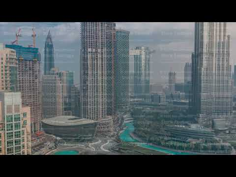 Dubai Opera located in Downtown and surrounded by skyscrapers in Dubai timelapse