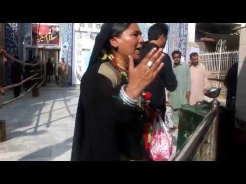 A devotee singing at the shrine of Lal Shahbaz Qalandar