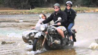Bean're and friends ride across a river in Vietnam
