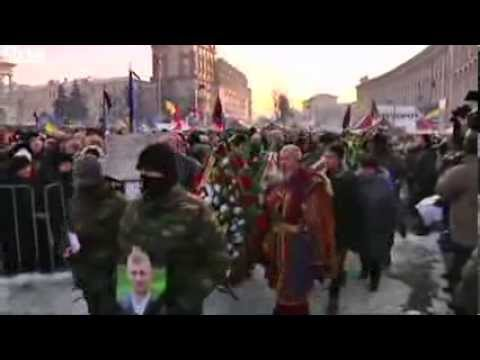 Ukraine crisis: Mourning in Kiev while protests spread
