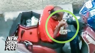 Delivery guy caught eating customers' food | New York Post