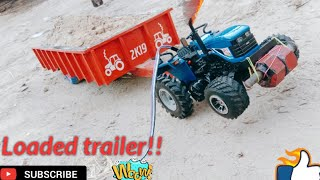 Toytractor pulling loaded trolley// new holland  tralle te sirra kraunda