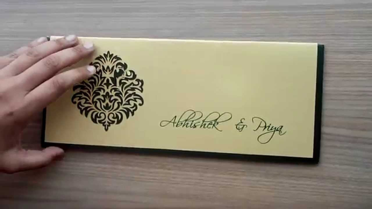 indian wedding card in dark green and golden with cutout design