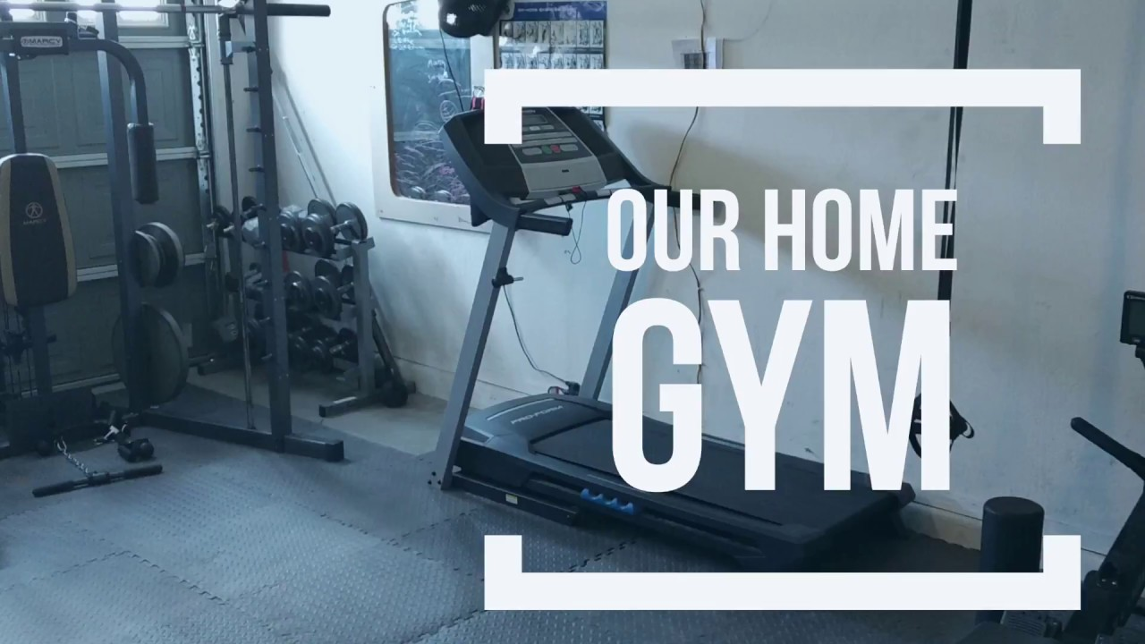 Garage home gym setup free weights cardio all fits