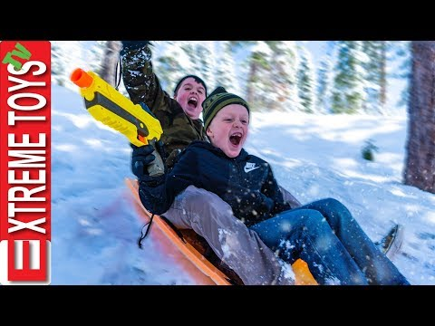 Last Day of Spring Break Snow Mayhem! Ethan VS. Cole Sledding Nerf Blast!
