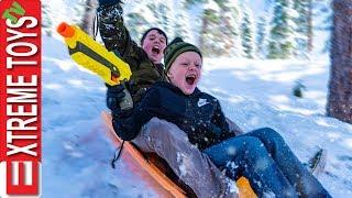 Last Day of Spring Break Snow Mayhem! Ethan VS. Cole Sledding Nerf Blast!