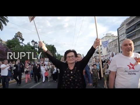 Greece: Soviet hero's daughter leads march of hundreds in Athens for V-Day