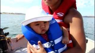 Baby falls asleep riding on boat