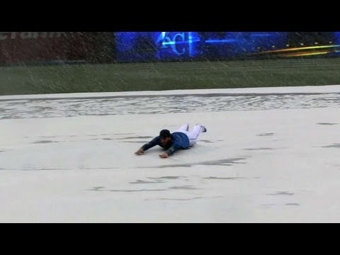 SLIP 'N SLIDE! Wild weather brings some snow and fun on the tarp
