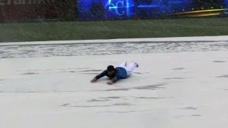 SLIP 'N SLIDE! Wild weather brings some snow and fun on the tarp thumbnail
