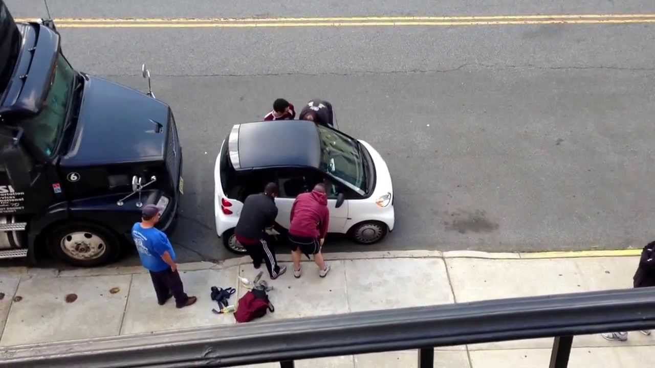 5 Guys Illegally Lift A Smart Car
