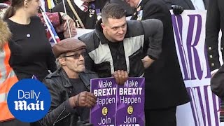 Tommy Robinson joins Brexit march as counter protests take place