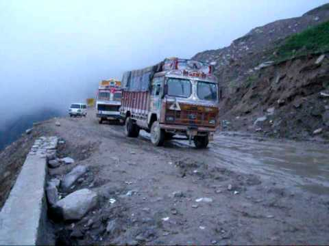 Indian trucks fight with deep mud in Indian Himalayas on high pass.  My way to Manali