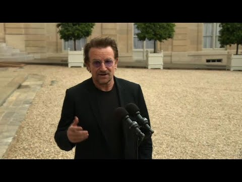 AFP news agency: U2 frontman Bono meets French President for