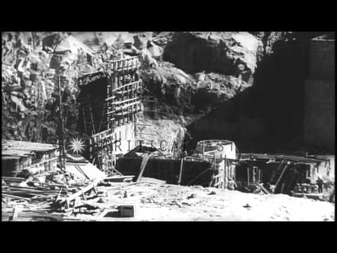 Men at work at the Aswan dam construction site across River Nile in Egypt. HD Stock Footage