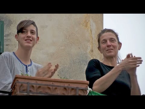 Italians clap on their balconies to thank medical staff amid coronavirus lockdown