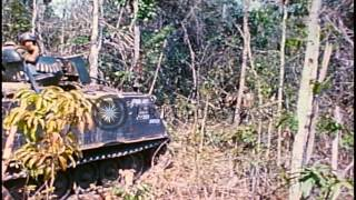 US 1st Infantry Division soldiers on foot and M-113 APCs move through a bombed-ou...HD Stock Footage