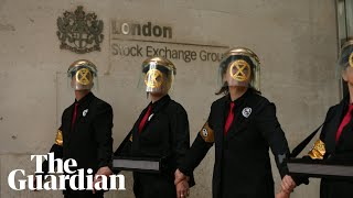 Extinction Rebellion activists glue themselves to London Stock Exchange in fresh protest