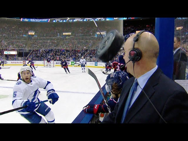 Hockey gods on Pierre McGuire's side after puck flies between the benches