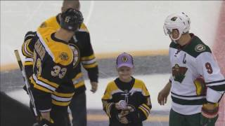 Young cancer patient Tommy Scardina drops the puck in Boston